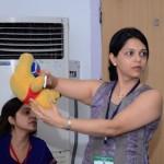 Dr Anjali Kulkarni, HOD, Fetal Medicine, Deenanath Mangeshkar Hospital, Pune trying to explain cardiac scanning planes on a model (The ACFM Bear).